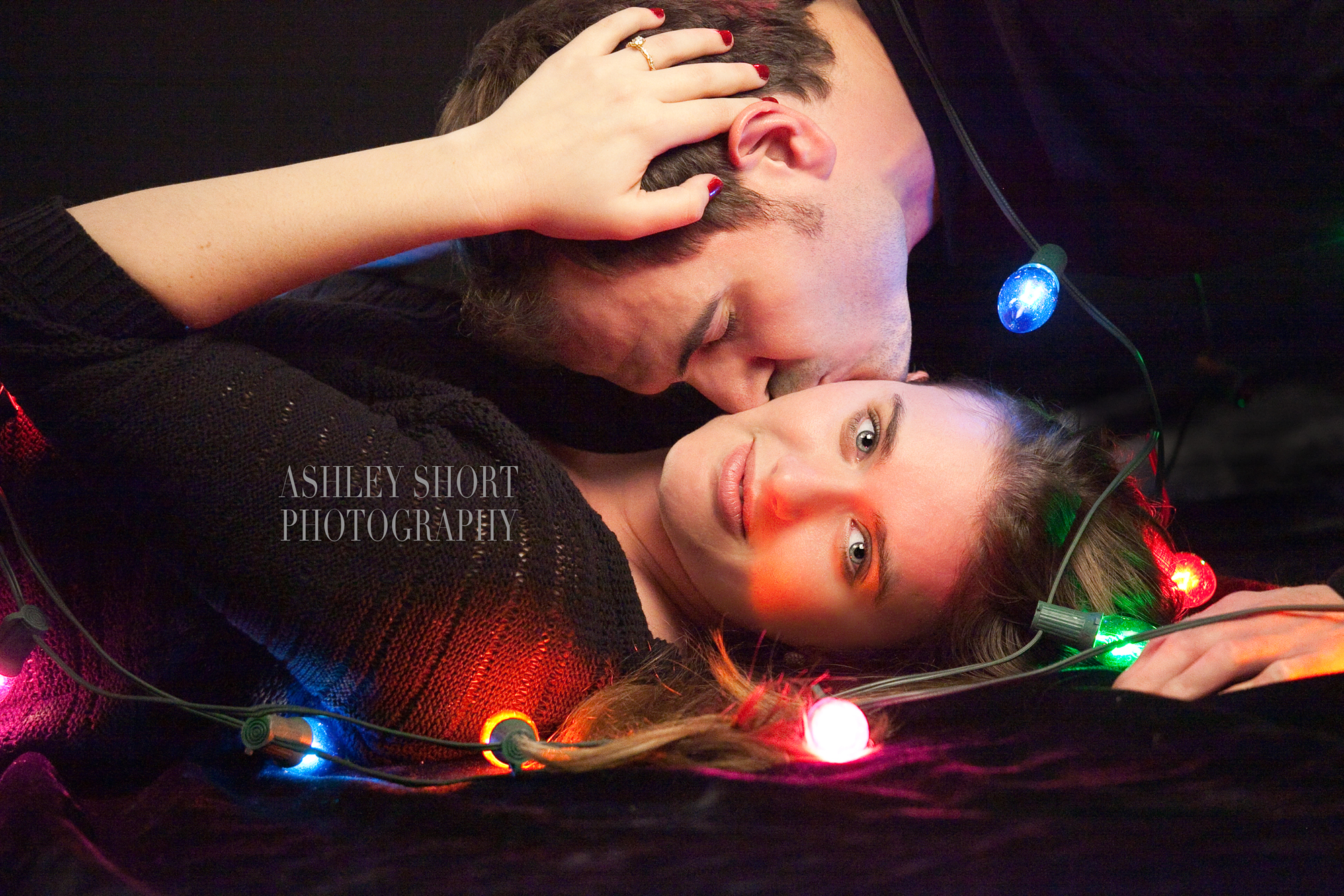 engagement portrait, couples portrait, fun engagement pictures, vintage christmas lights, ashley short photography, toledo ohio photographer, archbold ohio photographer, couple in love, fun engagement portrait, romantic engagement picture, woman being kissed