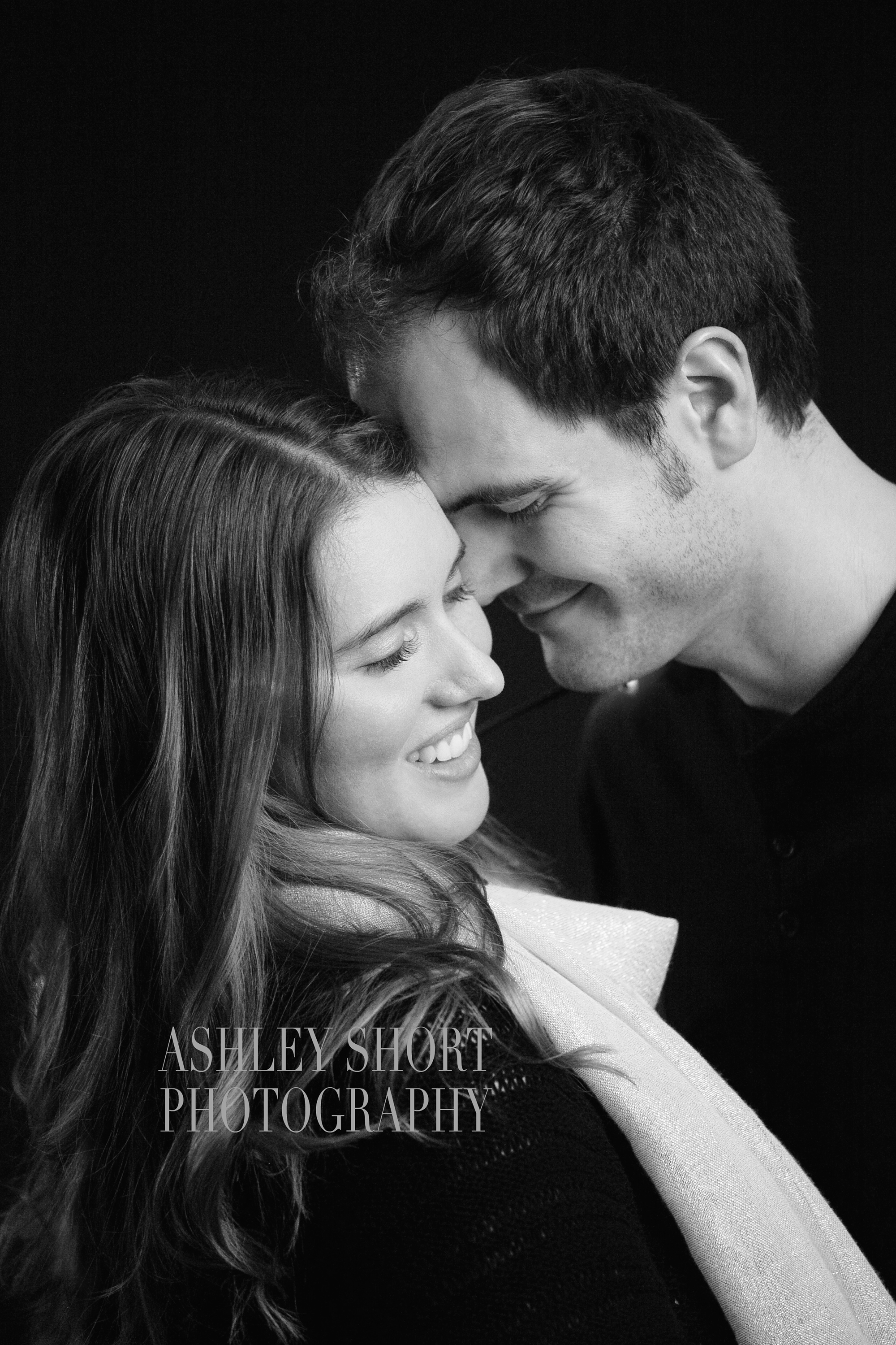 engagement portrait, couples portrait, fun engagement pictures, vintage christmas lights, ashley short photography, toledo ohio photographer, archbold ohio photographer, in love, black and white portrait
