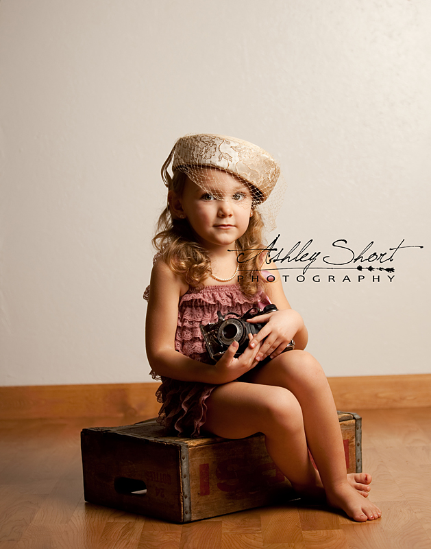 Toledo, ohio photographer, vintage camera and vintage hat make this girl