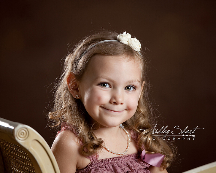 Toledo children photographer.  Lace, bows, and pearls make up a little girl