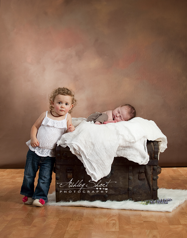 Sibling photograph with props, toddler and newborn, Toledo Ohio Photographer